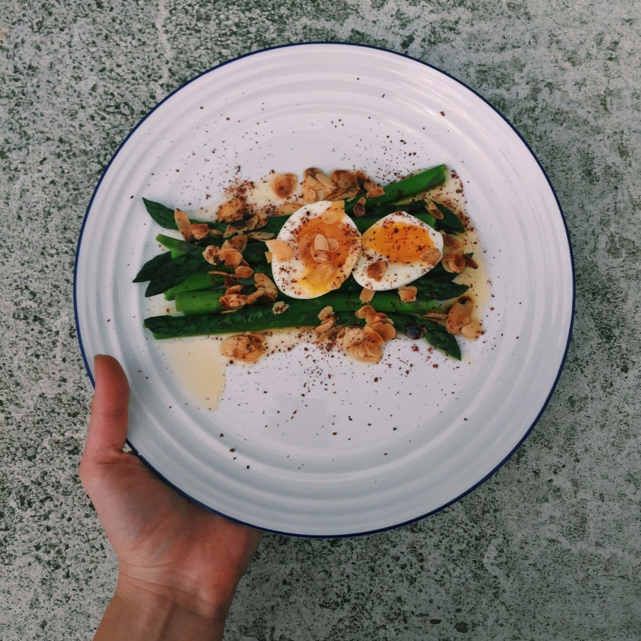 Asparagus with soft-boiled egg, almond butter andsumac